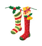 Christmas socks. Vector illustration of christmas socks hanging on a wire Royalty Free Stock Photo