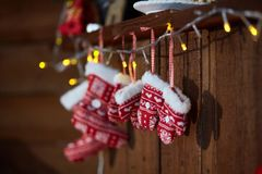 Christmas socks and winter knitted mittens. With Snowflake and Heart Motives. royalty free stock images