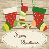 Christmas socks on wooden background Royalty Free Stock Images
