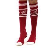 Christmas socs. Woman's legs, isolated, in Christmas socs Stock Image