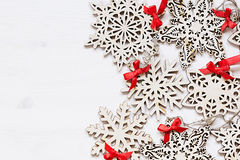 Christmas soft beige wooden snowflakes on a wood white  background. Royalty Free Stock Image