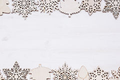 Christmas soft beige wooden snowflakes on a wood white  background. Royalty Free Stock Photography