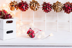 Christmas soft home craft decorations and burning lights on a wood white  background. Stock Image