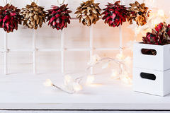Christmas soft home craft decorations and burning lights on a wood white  background. Stock Images