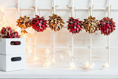 Christmas soft home craft decorations and burning lights on a wood white  background. Royalty Free Stock Photos