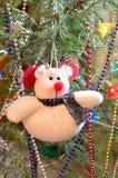 Christmas soft toy-bear. Christmas composition. Christmas soft toy-bear. Christmas song, the garland, beads and ornaments on a Christmas tree stock image