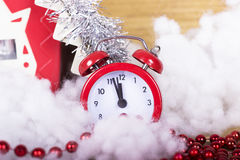 Christmas song with a house and an alarm clock. Royalty Free Stock Photo