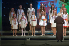 Christmas songs. DNEPROPETROVSK, UKRAINE - JANUARY 24: Unidentified Children, ages 9-15 years Stock Photo