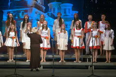 Christmas songs. DNEPROPETROVSK, UKRAINE - JANUARY 24: Unidentified Children, ages 9-15 years Royalty Free Stock Photos