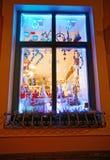 Christmas souvenirs seen through a window. RIGA, LATVIA - DECEMBER 28, 2014: Christmas tree decorations and other souvenirs seen through a frosted window on a Royalty Free Stock Photo