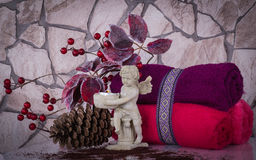Christmas SPA composition with towels and  angel. Christmas SPA composition with towels, angel statuette and organic elements Stock Photo