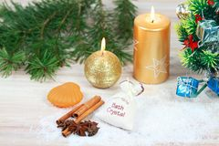 Christmas spa concept with candles and Christmas tree. Royalty Free Stock Photo