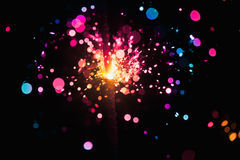 Christmas sparkler. Festive christmas sparkler with huge amount of multicolored sparks Royalty Free Stock Photo