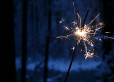 Christmas sparkler. Beautiful bengal light on tha dark background Royalty Free Stock Photos
