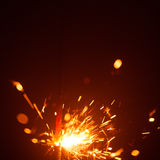 Christmas sparkler with red light Royalty Free Stock Photo
