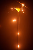 Christmas sparkler with red light Royalty Free Stock Photos