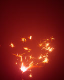 Christmas sparkler with red light Royalty Free Stock Image