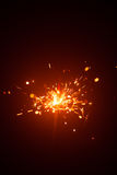 Christmas sparkler with red light Royalty Free Stock Images