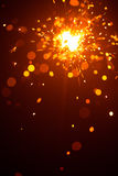 Christmas sparkler with red light Stock Photos