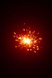 Christmas sparkler with red light Royalty Free Stock Photography