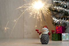 Christmas. Sparklers. Snowman. Gifts Royalty Free Stock Images