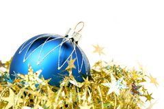 Christmas sphere of dark blue color and tinsel. Christmas sphere of dark blue color and celebratory tinsel on a white background Royalty Free Stock Photos
