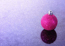 Christmas sphere laying on granite Royalty Free Stock Photography