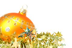 Christmas sphere of yellow color and celebratory tinsel 5. Christmas sphere of yellow color and celebratory tinsel on a white background Royalty Free Stock Image
