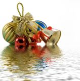 Christmas spheres. And Handbell in water stock photos