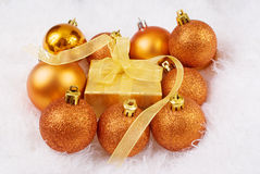 Christmas spheres and box. On the white fur Royalty Free Stock Photography