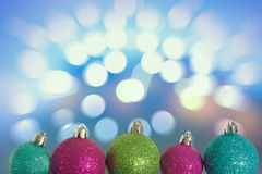 Christmas spheres in front of light bokeh Stock Images
