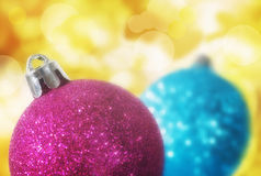 Christmas spheres in front of light bokeh Royalty Free Stock Photos