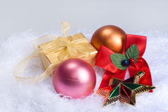 Christmas spheres and gift Stock Photos