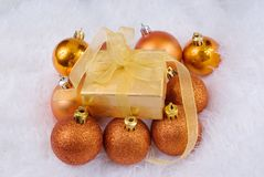 Christmas spheres and golden box Stock Photo