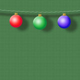 Christmas spheres on a green background. Three New Year's spheres on a green background Royalty Free Stock Image