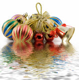 Christmas spheres and handbell. On a white background stock photos