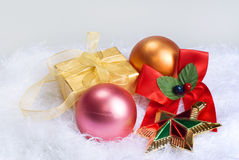 Christmas spheres, star and gift. On a skin Stock Images