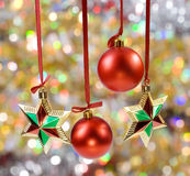 Christmas spheres and stars. On the color background Stock Images