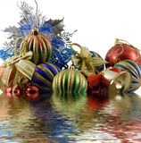 Christmas spheres in a tinsel. On a white background royalty free stock photos