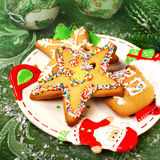 Christmas spice-cake and decor. Tasty spice-cakes on a holiday and Christmas decor Stock Images