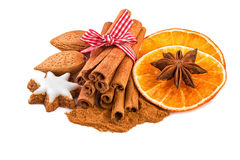 Christmas spice decoration with cinnamon, anise, almond nuts and orange slices Stock Images