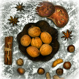 Christmas spicery, nuts and decorations Royalty Free Stock Photos