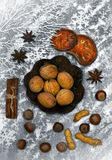 Christmas spicery, nuts and decorations Stock Images