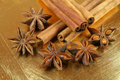 Christmas spices. Anise stars and cinnamon sticks on golden cracked background Stock Photo