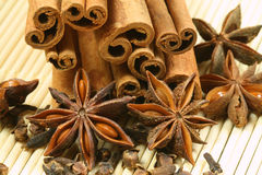 Christmas spices. Anise star, cinnamon sticks and cloves on bamboo background. Christmas ingredients Royalty Free Stock Photography