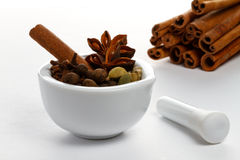 Christmas spices. In a white mortar Stock Photo