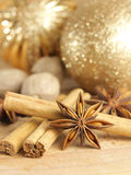 Christmas spices and baubles Stock Photo