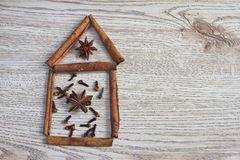 Christmas spices: cinnamon, anise, cloves. On the wooden table Stock Image