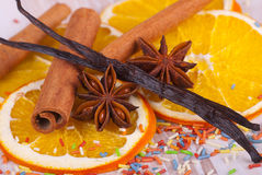 Christmas spices. Cinnamon sticks, anise stars, vanilla and dried orange slices Royalty Free Stock Photo