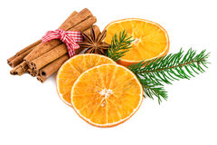 Christmas spices with cinnamon sticks and dried orange slices on white Stock Image